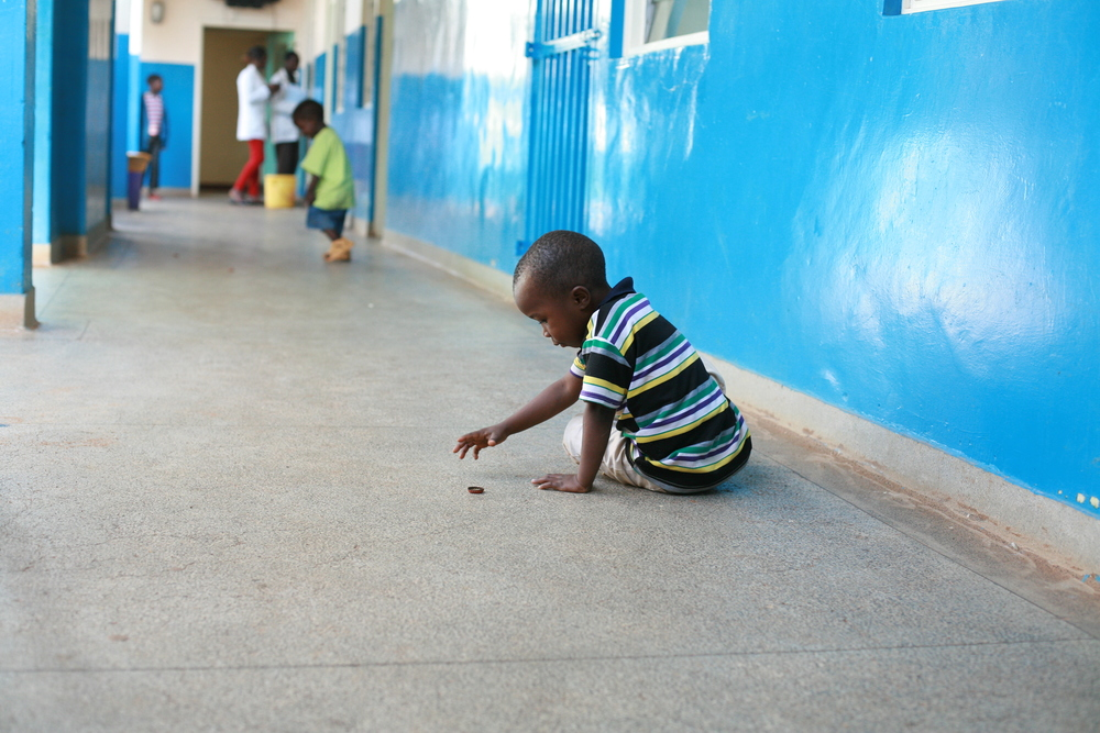 A child playing on one of  the corridors of ward 8. He is one of the children the hospital keeps in the facility because the parents havent paid for the medical bill..JPG