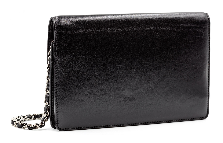 ac59cd9282c3c6 Black Lambskin Chanel Bag with Studded Logo — Harriett's Closet