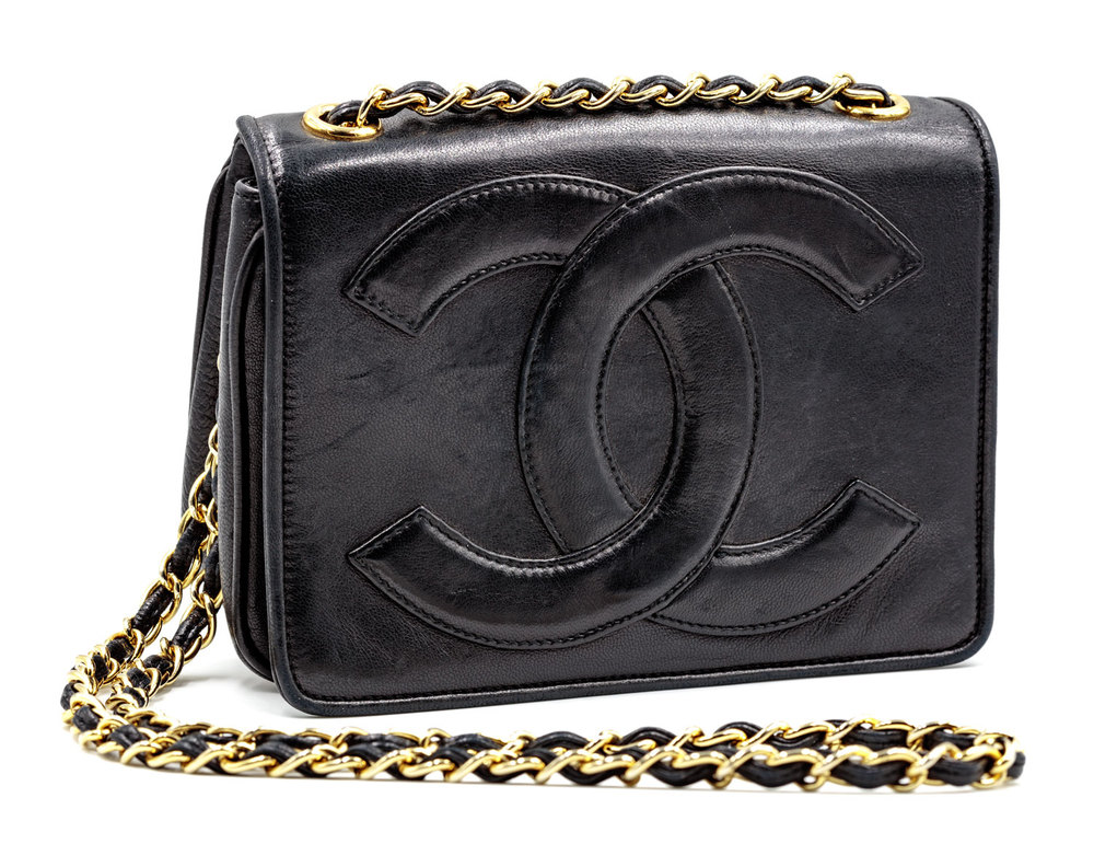 e4469d6960070a Black Chanel Leather Bag with Leather Logo — Harriett's Closet