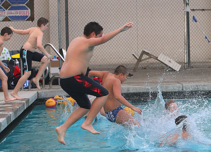 Coaching Kids Jumping In.jpg