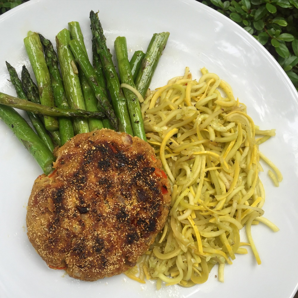 Chickpea-bean veggie burger + sautéed spiralized yellow squash + sautéed asparagus in coconut oil spray and coconut aminos