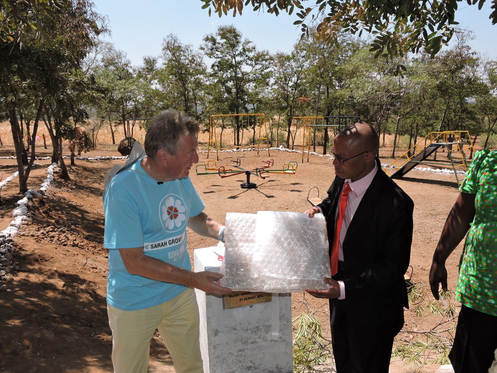 "Presentation and unveiling of plaque which reads ""In loving memory of Sarah Groves, who visited Mgungani School in 2012.  Sarah Groves Foundation 27 August 2014"""