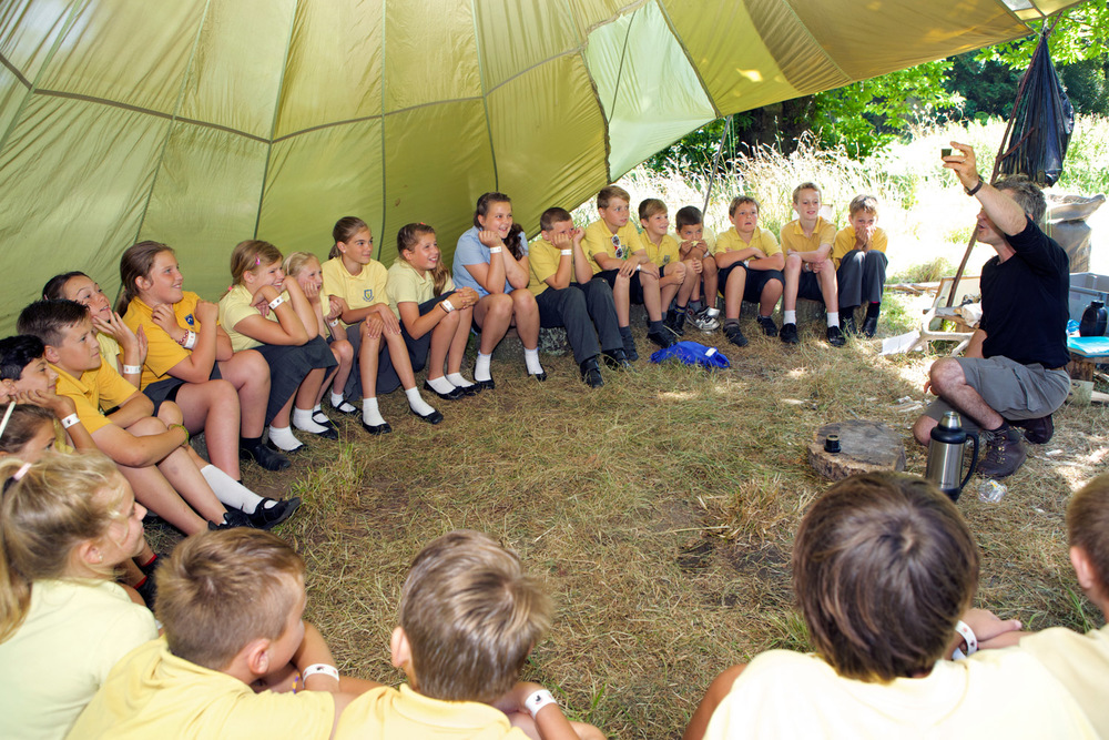 Bush craft expert David Hunt shows Castel Primary School children how to make fire using a flint and the fungus King Alfred's or coal fungus. Photo copyrighted and provided with permission of Sealord Photography, Guernsey.