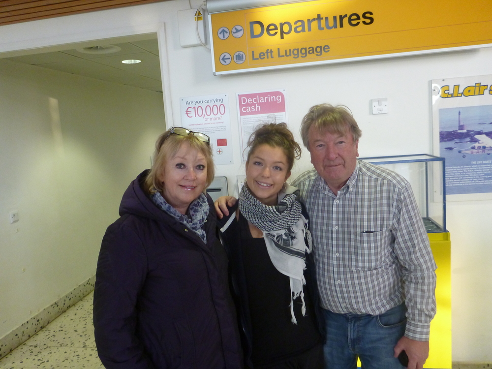 Sarah at Guernsey airport with her parents