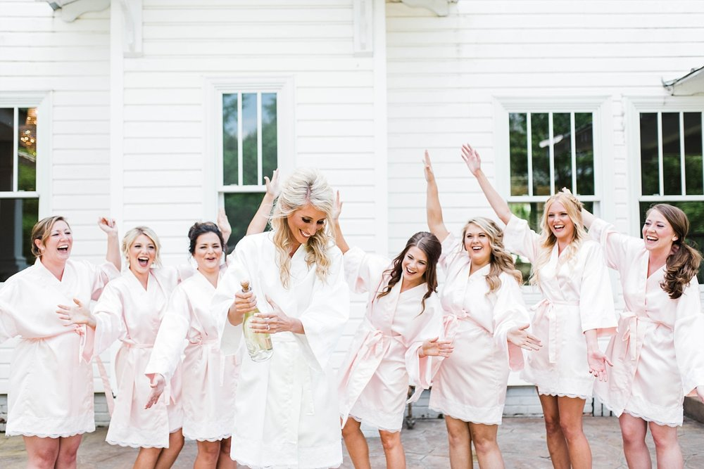 BRIDE WITH CHAMPAGNE | BRIDE WITH BRIDESMAIDS | ELEGANT SPRING WEDDING AT THE SONNET HOUSE | TJ & SHELBY | JOHNSON WEDDING