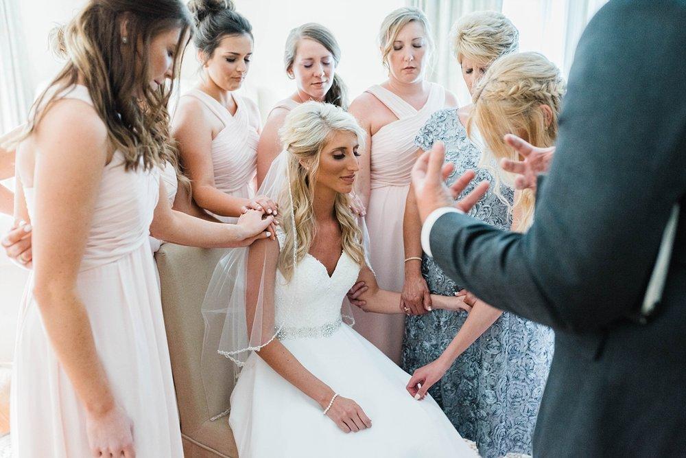 BRIDE PRAYING | BLUSH & NAVY | ELEGANT SPRING WEDDING AT THE SONNET HOUSE | TJ & SHELBY | JOHNSON WEDDING