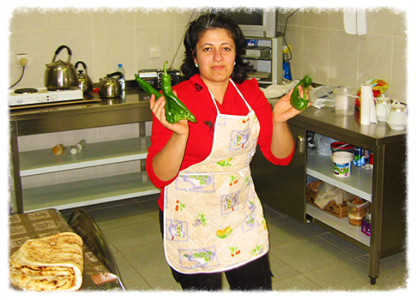 Awat working as a cook at the Chaldean Catholic Seminary in Erbil, Iraq