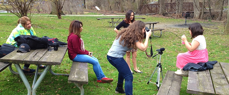 Photographer Heather Wilson snaps production stills of the girls during filming.