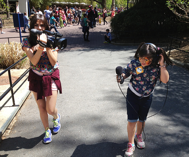 Lilyan and Lubna practice their cinematography skills at the National Zoo in Washington, D.C.