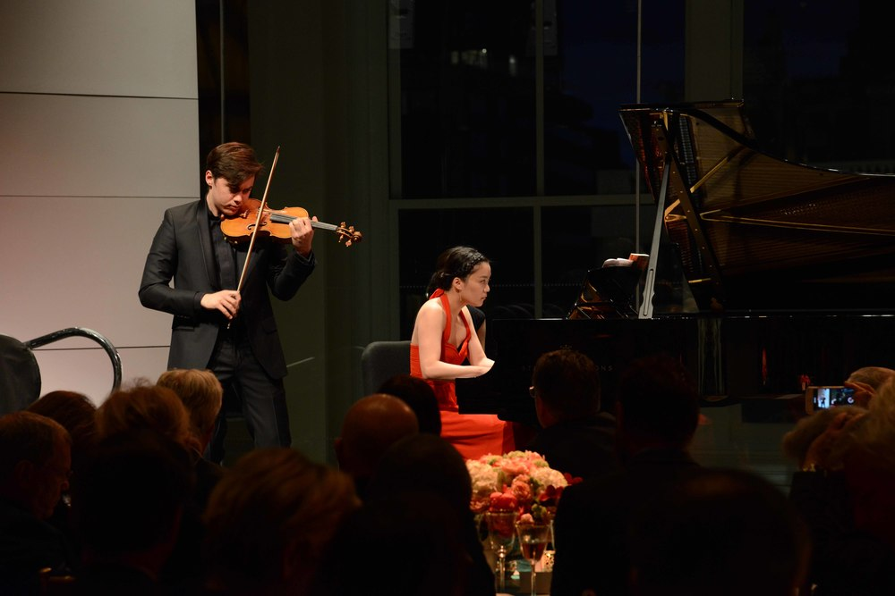 June Wu and violinist Benjamin Beilman perform at the 2015 Carnegie's Chairman's Concert in the Weill Music Room.