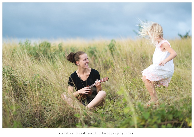 playing ukulele in the field