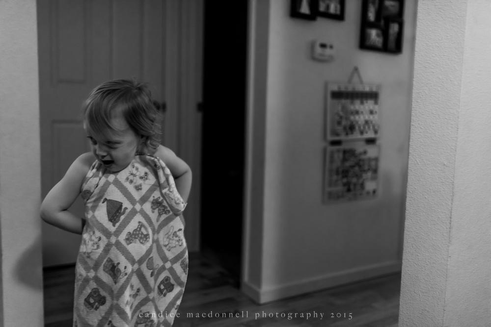 little boy in blanket being silly © candice macdonnell 2015