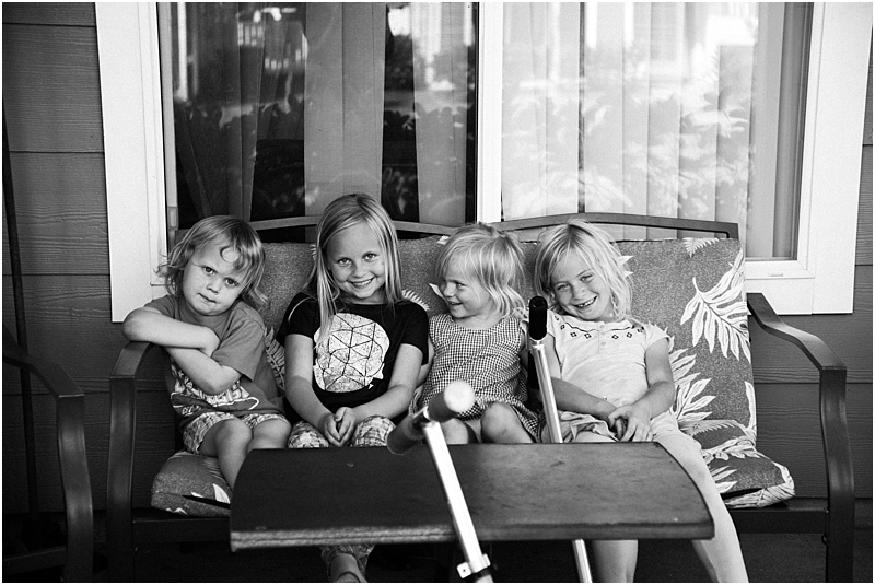 friends sitting on patio lifestyle family photographer