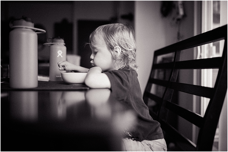 reflection in table child eating cereal lifestyle family photographer