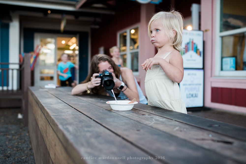 mom taking picture of her daughter being silly at matsamotos lifestyle photography by candice macdonnell photography, oahu hawaii documentary photographer