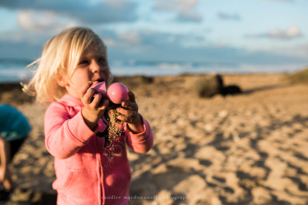 found easter egg on beach with sand inside lifestyle photography by candice macdonnell photography, oahu hawaii documentary photographer