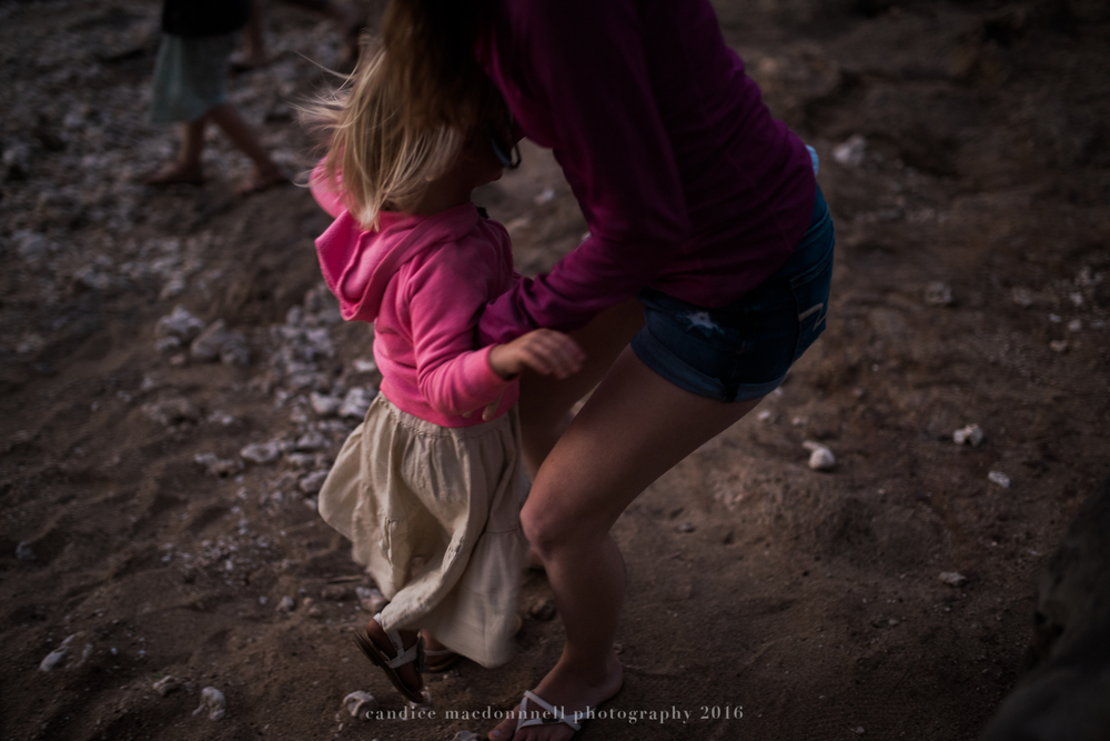 mom and daughter at kaena point beach lifestyle photography by candice macdonnell photography, oahu hawaii documentary photographer