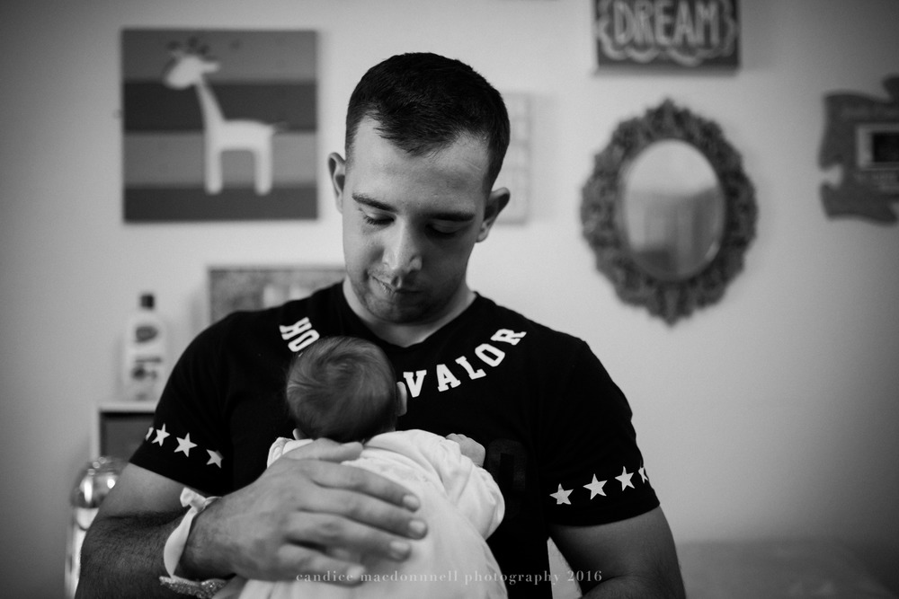 newborn baby with proud dad lifestyle photograph oahu hawaii photographer