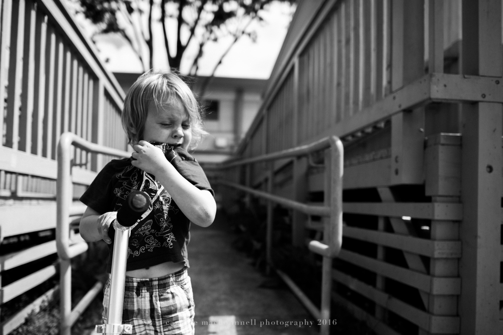 boy crying with scooter at school oahu hawaii family lifestyle photographer