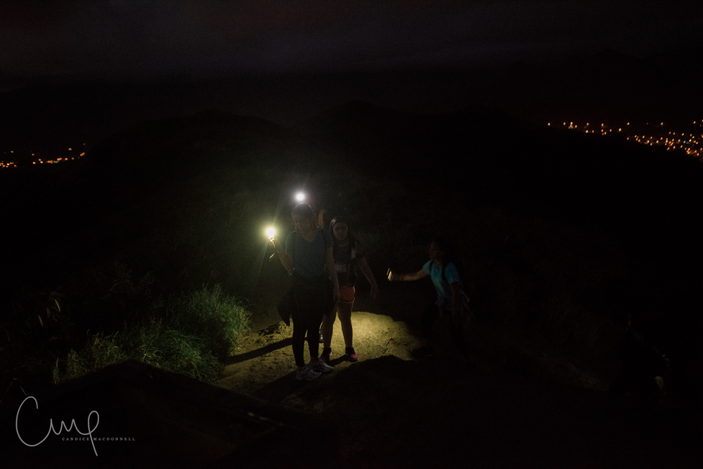 hiking up the pillboxes in the dark oahu hawaii lifestyle photographer