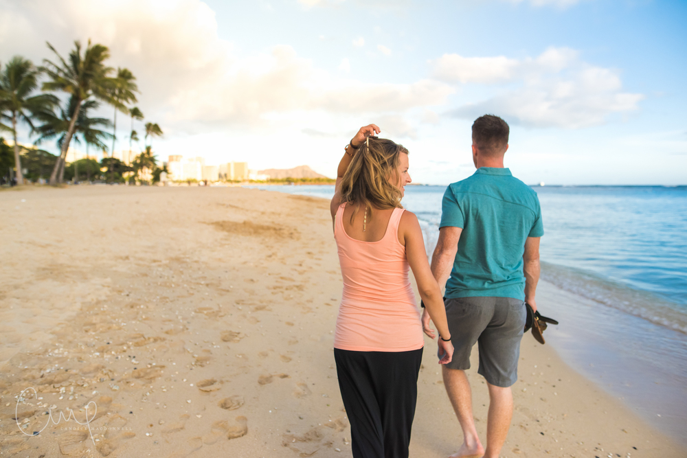 couple walking on beach oahu hawaii honolulu maternity photography