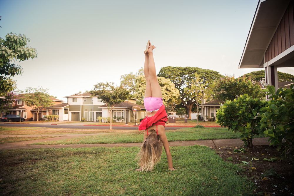 documentary photography of girl doing handstands