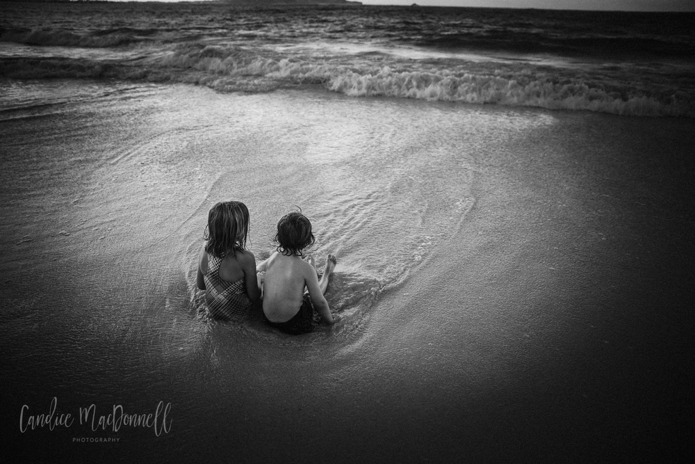 kids sitting in sand at kailua beach oahu hawaii photography