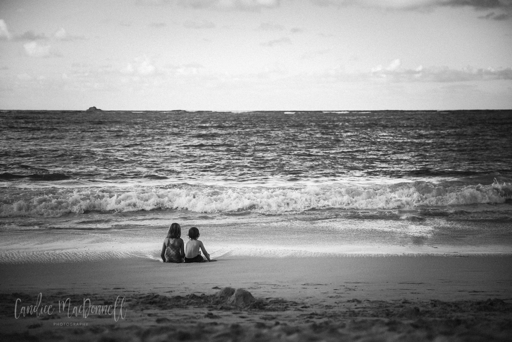 kids sitting at kailua beach oahu hawaii photography