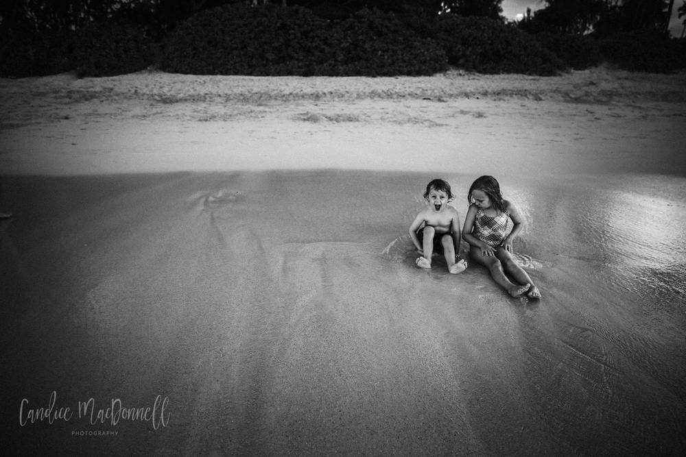 brother and sister playing at kailua beach oahu hawaii protographer