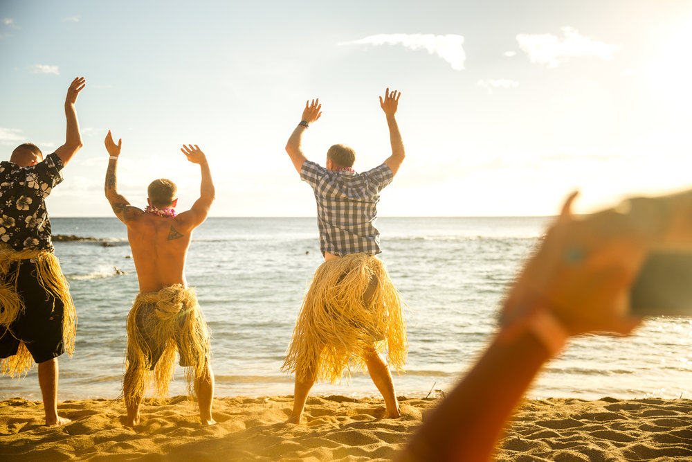 husband hula dancing at luau paradise cove family photographer