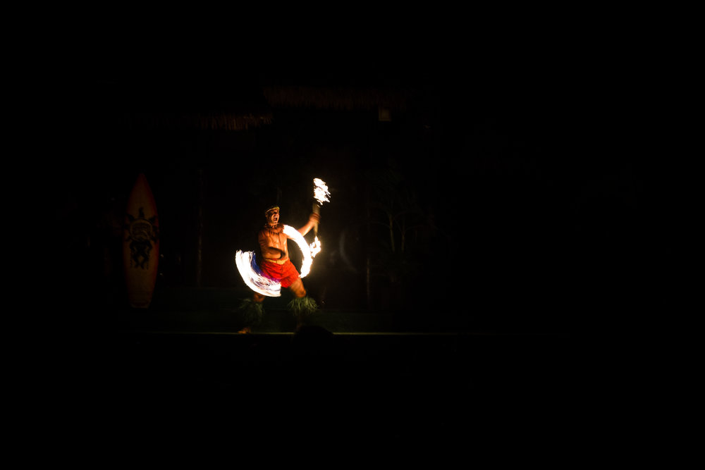 paradise cove fire dancer at luau documentary family photographer