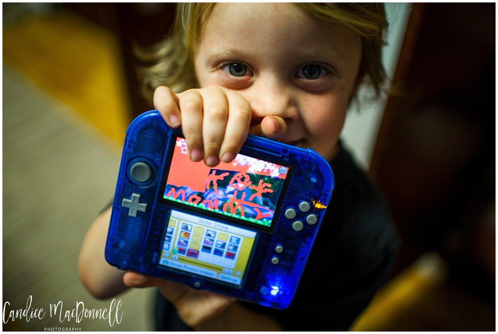 boy with video game picture documentary photographer hawaii