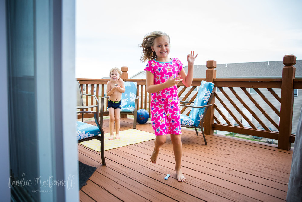 kids in pajamas on porch in winter -  www.candicemphoto.com mid missouri family documentary photography