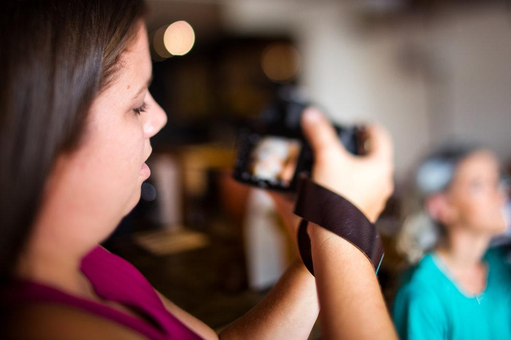 Boudoir photographer taking photographs during session