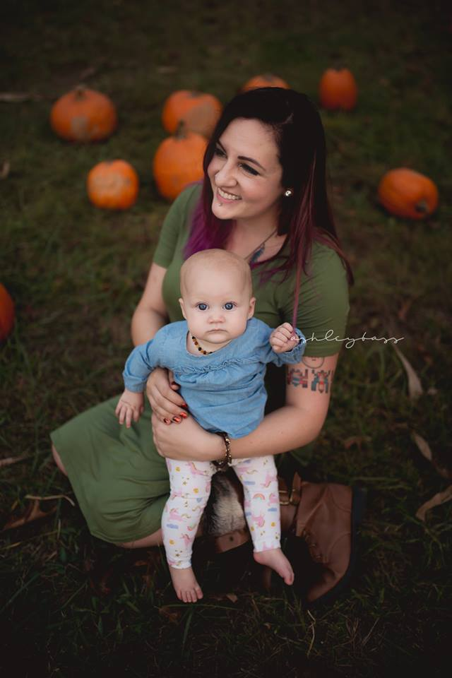 mom with pink hair and baby with pumpkins