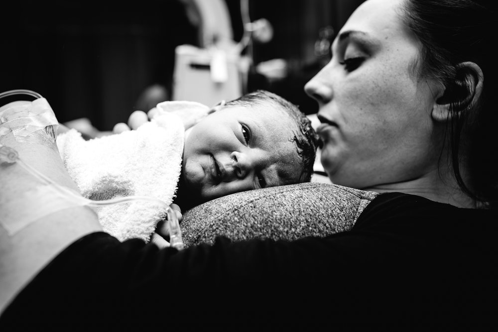 woman during childbirth at fort leonard wood hospital birth photography