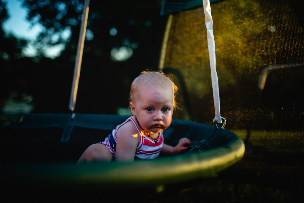 baby in disk swing with pretty sunlight waynesville missouri photography