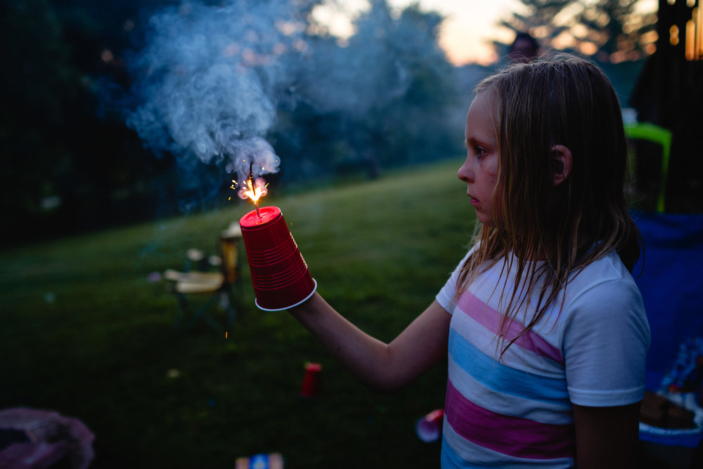 using a solo cup with a sparkler childhood photographer
