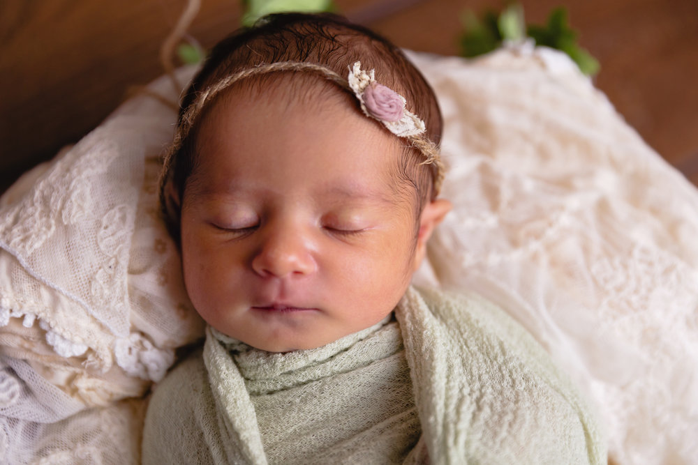 sleeping newborn photo green swaddle headband fort leoanrd wood mo baby photographer