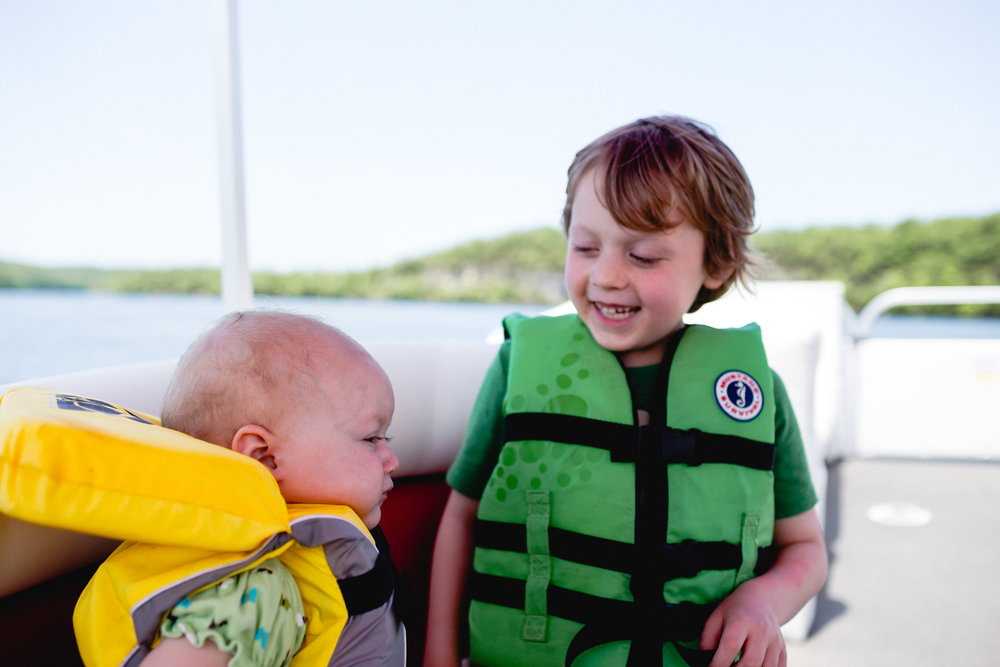 kids on a boat with life vest missouri fort leonard wood photographer