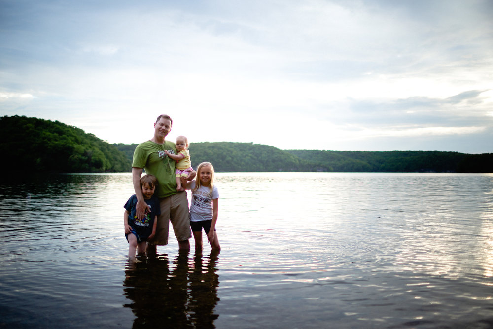 family standing in lake of the ozarks rec fort leonard wood photographer