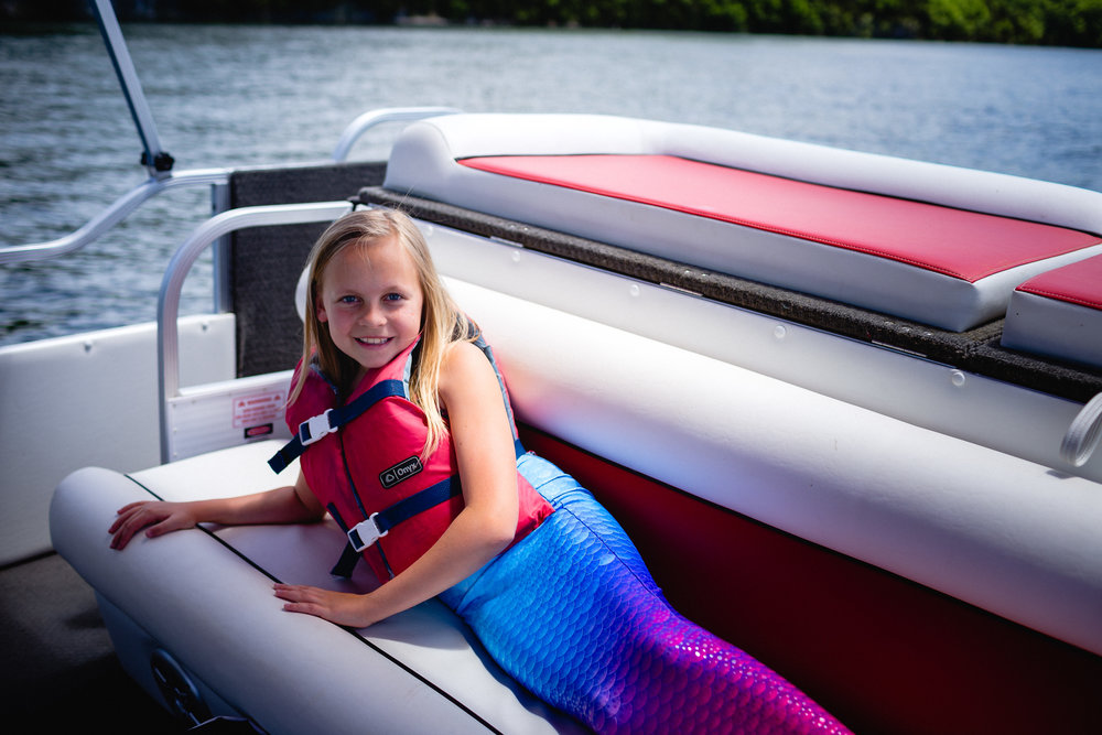 girl wearing fin fun mermaid tail waynesville photographer
