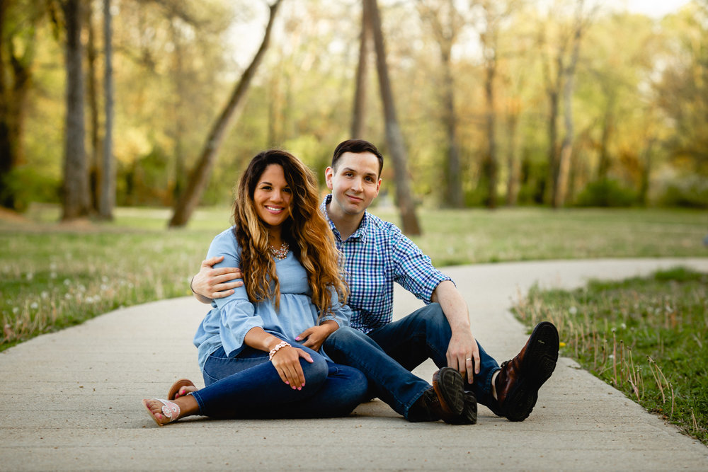 husband and wife in park during lifestyle maternity photo shoot fort leonard wood missouri