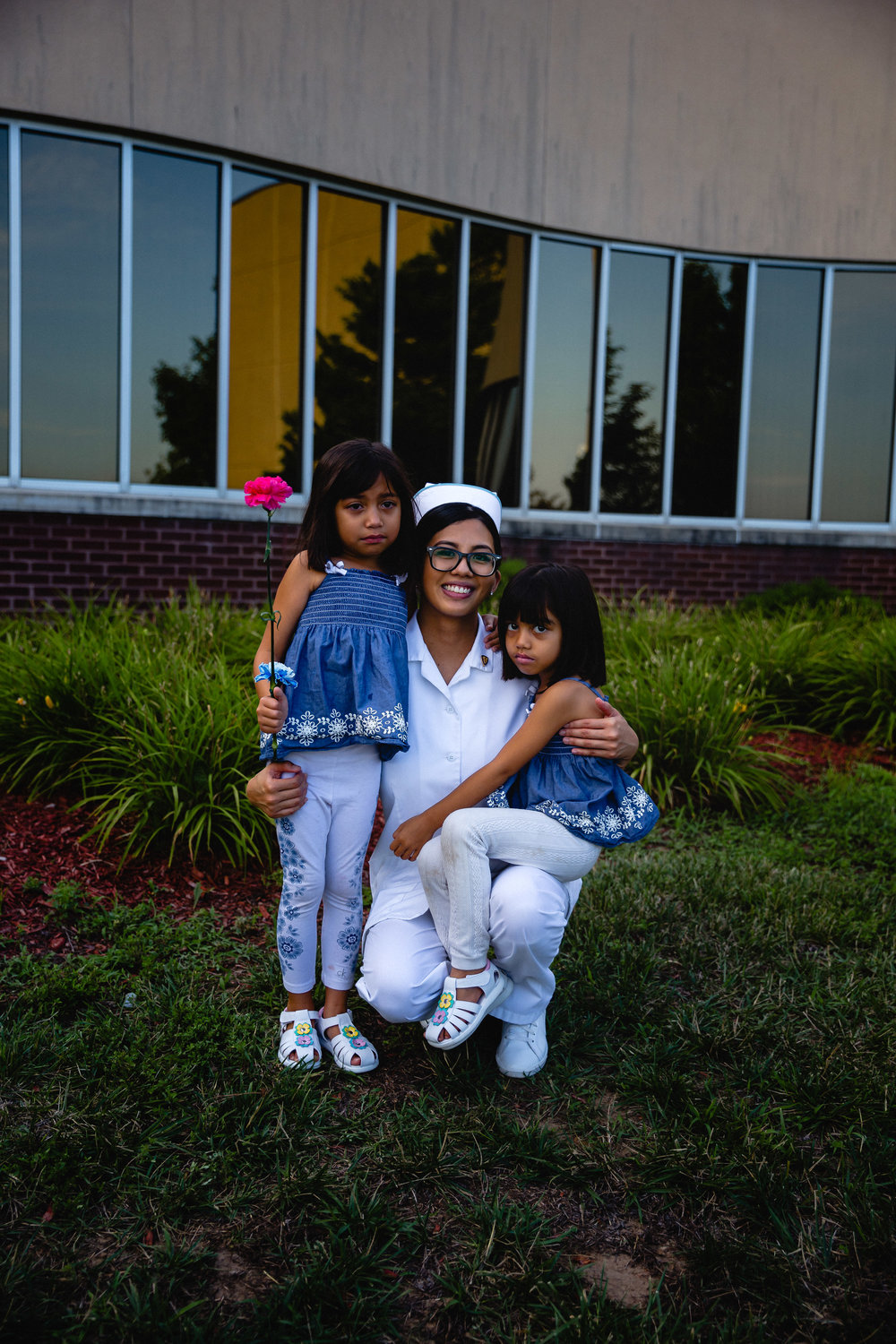 new graduate of waynesville practical nursing program with two daughters fort leonard wood event photography