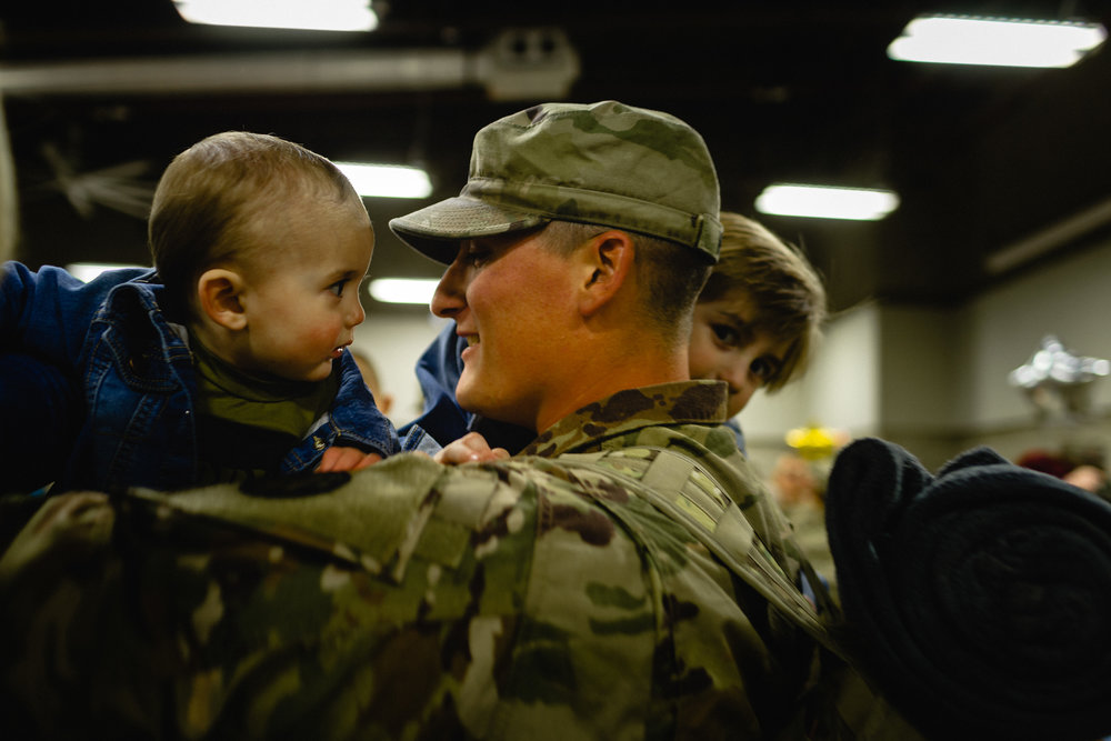 child reunited with army soldier at fort Leonard wood deployment homecoming ceremony