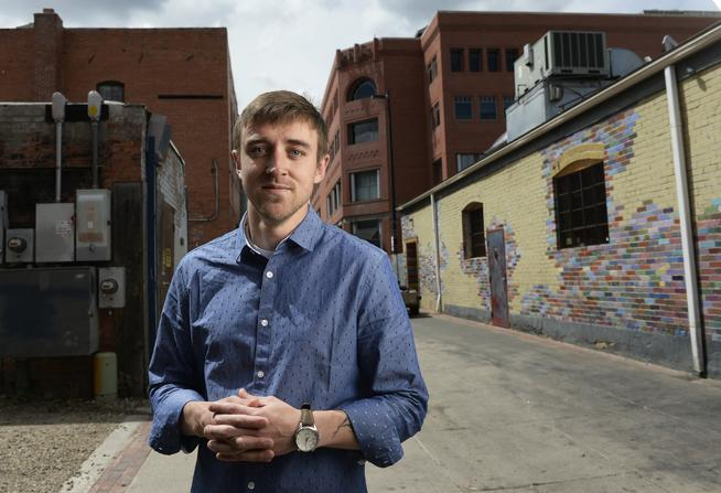 "Joseph Braun is editor of the literary magazine ""The Lune."" He posed in an alleyway near 13th and Pearl streets in Boulder, where he has held midnight, full-moon poetry readings. (Cyrus McCrimmon, The Denver Post)"