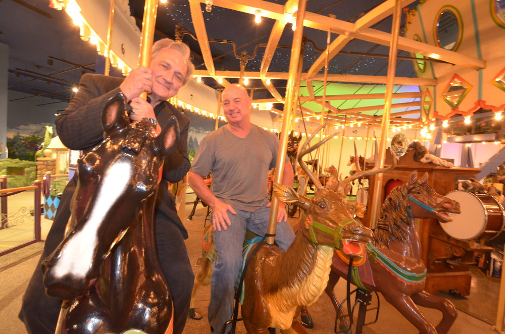 Tim & John riding carousel.jpg