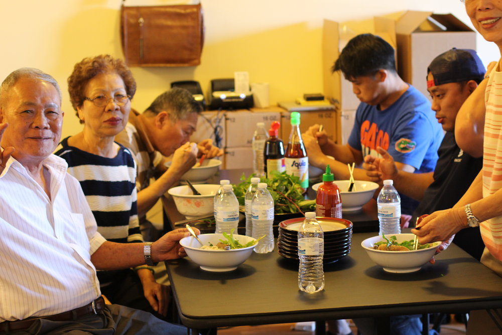 my dad is the one at the lower left and my moms is the one to his left  they look happy, everyone else is busy eating :)