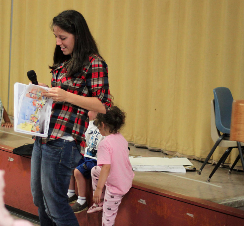 Reading at the Parent-Child Home Program (PCHP) graduation ceremony in June, 2013. Photo credit: Tony Penny