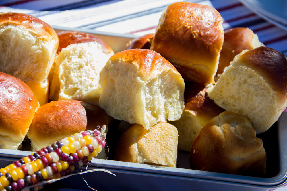 These rolls are getting more of a tan than I did all summer... Hawaiian Rolls Recipe